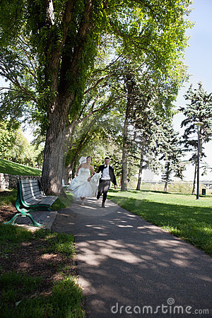 Newlywed Running Along Walkway