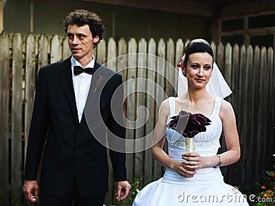 Newlyweds in courtyard
