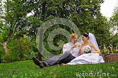 Newlyweds drinking wine