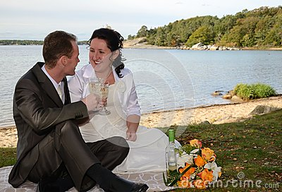 Newlyweds drinking wine outdoor