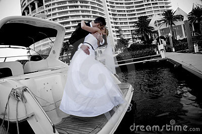 Newlyweds kissing on boat