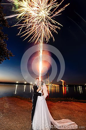 Free Newlyweds Kissing Near Lake By Night - Fireworks Stock Photography - 77204662