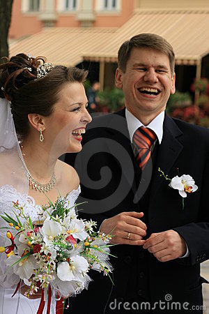 Newlyweds laughing