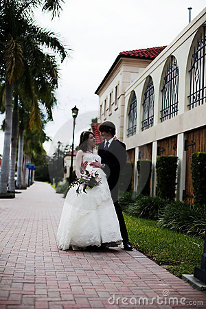 Newlyweds on sidewalk