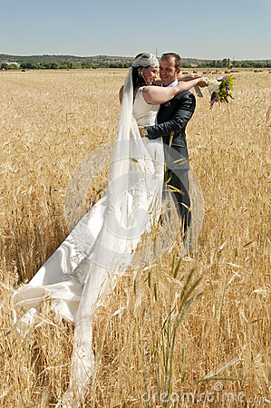 Newlyweds in the wheat field