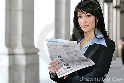 News: Business Woman Reading Newspaper