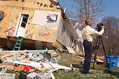 News reporter covering tornado aftermath Editorial Image