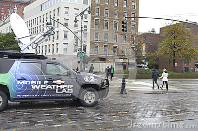 News reporter truck by the pier Editorial Stock Image