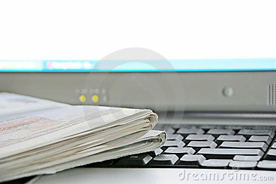 Newspaper and Computer