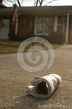 Newspaper on driveway