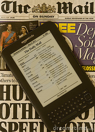Newspaper on Kindle Electronic E-Reader Editorial Photo