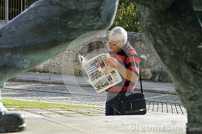 Newspaper reader, Viana do Castelo, Portugal Editorial Image
