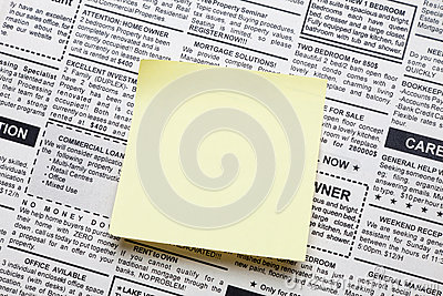 Newspaper and sticky note