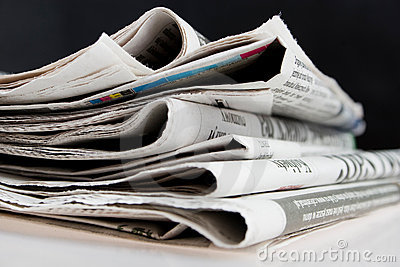 Newspapers on black background