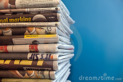 Newspapers piled up