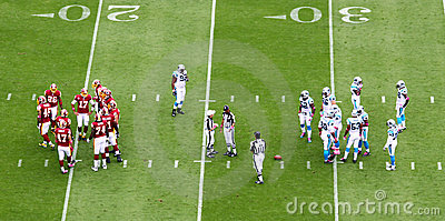 NFL - two teams in the huddle Editorial Stock Image