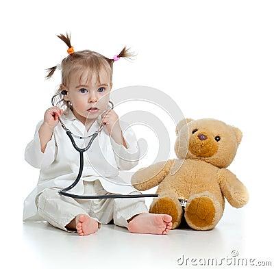 http://thumbs.dreamstime.com/x/ni%C3%B1o-con-la-ropa-del-doctor-y-del-oso-de-peluche-23783929.jpg