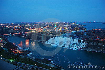 Niagara Falls and rainbow bridge at night