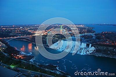 Niagara Falls and rainbow bridge at night