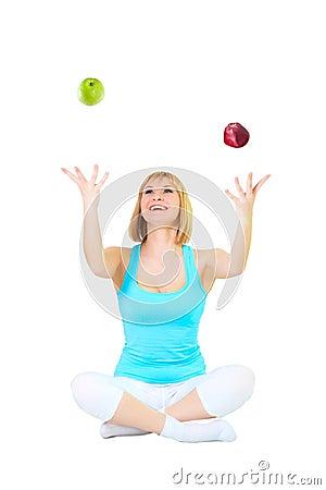 Nice blonde juggles apples