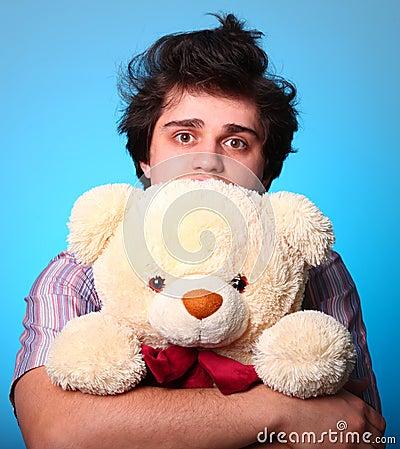 Nice boy with teddy bear in St. Valentine s Day