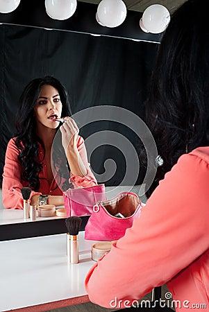Nice brunette colors lip near the mirror