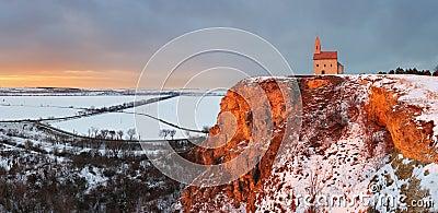 Nice Catholic Chapel in eastern Europe at winter landscape - vil