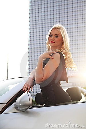 Nice girl in cabriolet car