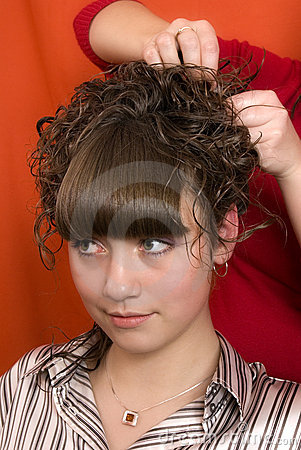 Nice girl in a hairdressing salon