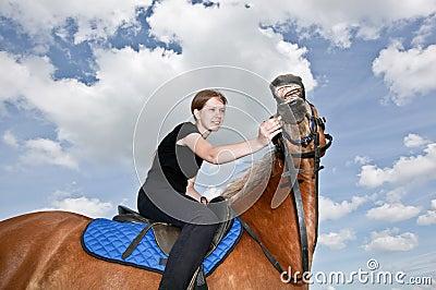 Nice Girl riding a Hors