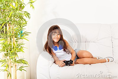 Nice girl with videogame control
