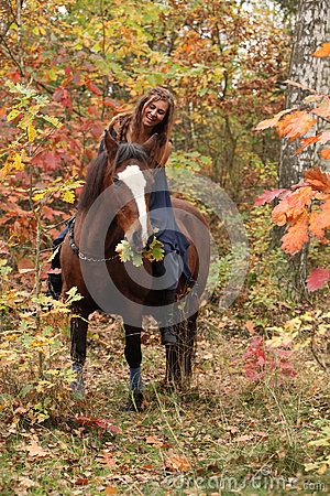 Free Nice Girl With Brown Horse In Autumn Stock Images - 49464004