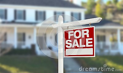 Nice Home For Sale Real Estate Sign in Front of Beautiful New House. Stock Photo