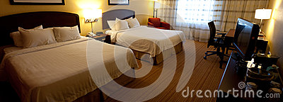 A nice hotel room interior with two beds