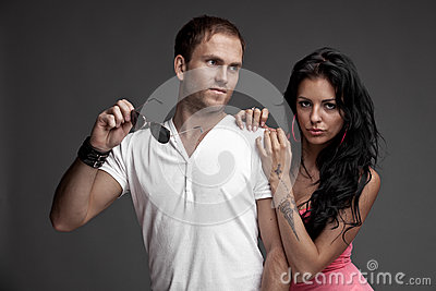 Nice likeable guy with girl on gray background
