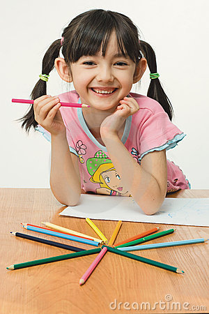 Nice little girl painting with pencils