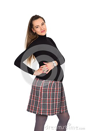 Nice pregnant girl in plaid skirt