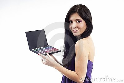 A nice woman holding an eyeshadow set
