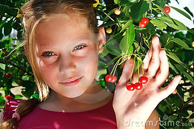 A nice young girl and red cherry