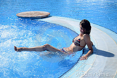 Nice young girl in the swimming pool