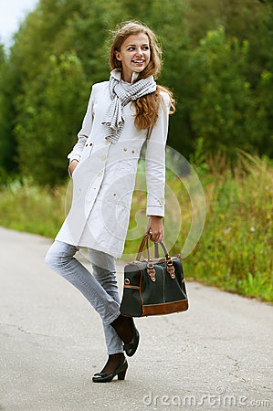 Nice young woman with handbag