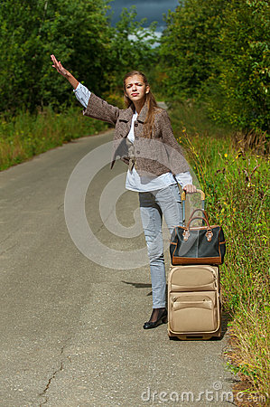 Nice young woman with road suitcase