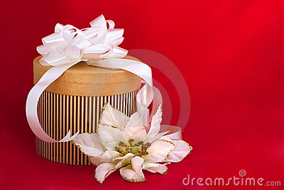 Nicely decorated gift on red background
