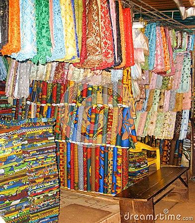 nigerian fabrics line a market stall stock photo image