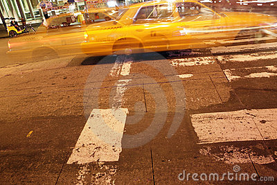Night capture of a taxi in New York City
