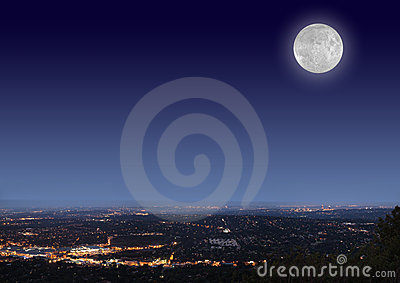 Night cityscape with moon