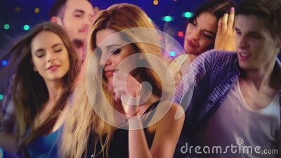 Night club with dancing, meeting and flirting people stock video footage