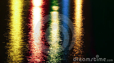 Night colorful abstract lights reflections on lake