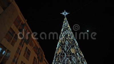 Night garlands and Christmas tree for the New Year in the Portugal city of Faro zbiory wideo