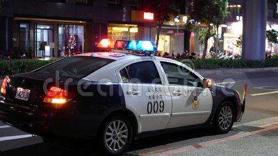 Night outdoor shot of red and blue emergency lights of police car. In Taipei Taiwan